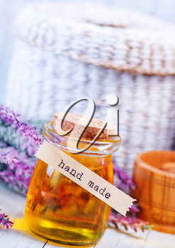 lavender oil in glass bottle on the table