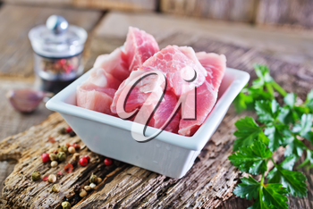 raw meat in bowl and on a table