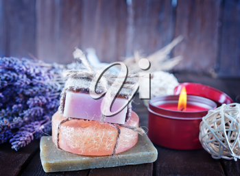 handmade soaps on the wooden table, spa objects
