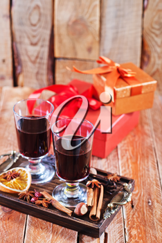 mulled wine with spice on a table