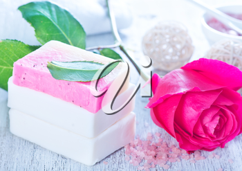 aroma soap and rose on a table