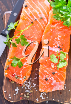 salmon with salt and pepper on board