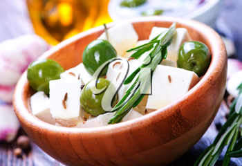 feta cheese with rosemary and green olives