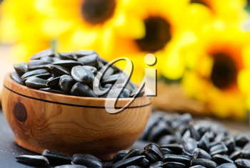 sunflower seed in bowl and on a table