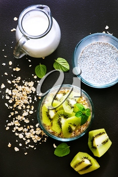 milk with chia seeds and kiwi in the bowl
