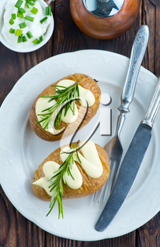 baked potato on plate and on a table