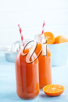 fresh fruit juice in bottle and on a table