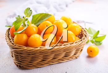 fresh plums on a table, stock photo
