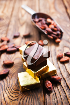 chocolate and cocoa beans on a table