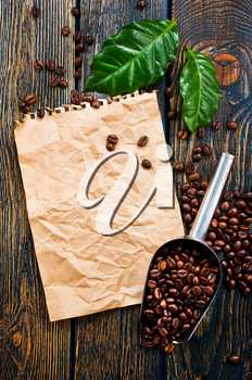 coffee beans on the wooden table, stock photo