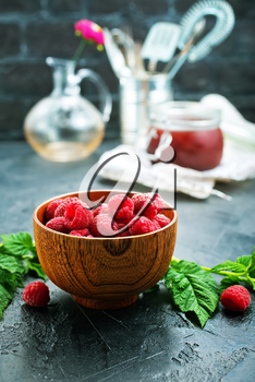 fresh raspberry in bowl and on a table