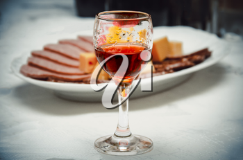 A glass of wine and lip print on the contrasting background of the festive table