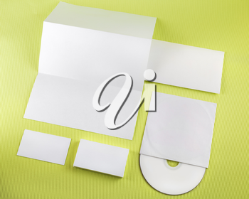 Photo of blank corporate identity set on green background.. Template for branding identity. Top view.