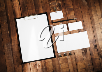 Blank stationery set on wooden table background. ID template. Mock up for branding identity for design presentations and portfolios. Top view.