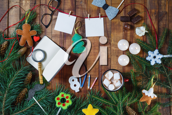 Christmas holidays composition on wooden background. Festive still life. Flat lay.