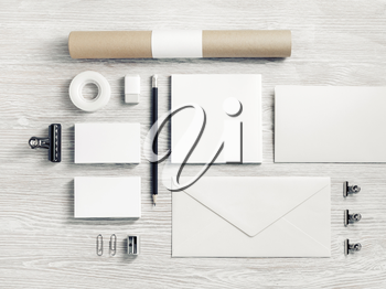Blank branding identity set on light wood table background. Stationery template. Flat lay.
