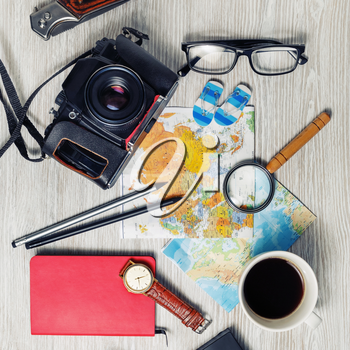 Vintage tourist devices on light wood table background. Preparation for travel. Top view. Flat lay.