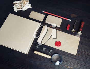 Photo of blank vintage stationery set on wooden background. Corporate identity mock up for placing your design.