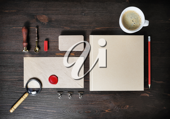 Retro stationery template on wood table background. Mock up for branding identity. Top view. Flat lay.