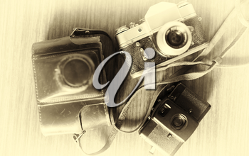 Horizontal vintage three cameras bokeh background