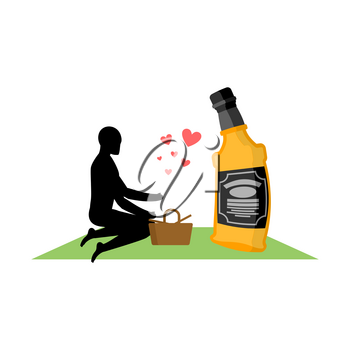 Lover alcohol drink. Man and bottle of whiskey on picnic. blanket and basket for food on lawn. Romantic date. Alcoholic Lifestyle