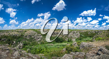 Panoramic view of deep granite Aktovo canyon with river and cloudy sky, One of the natural wonders of Ukraine.