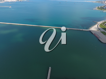 Top view of the bay Tsemess. The international sea port of Novorossiysk. Mol - building to stop the waves.