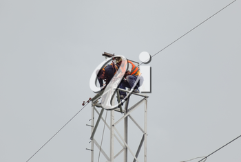 Russia, village Poltavskaya - June 23, 2015: Power line support, insulators and wires. Appearance of a design. Assembly and installation of new support and wires of a power line.