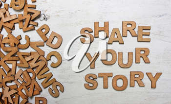 share your story It is written wooden letters