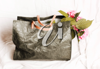 Bag green khaki casual with flowers inside on a white background