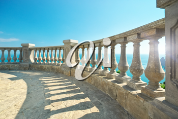 Beautiful seascape, view from stone balustrade on sunny summer day. Element of design.