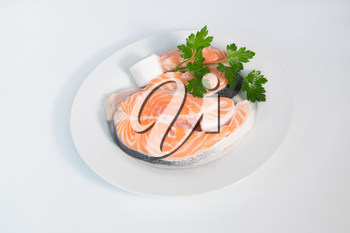 Fresh trout on the white plate, served with parsley closeup
