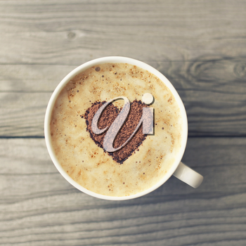 Heart from chocolate on coffee. Concept and idea