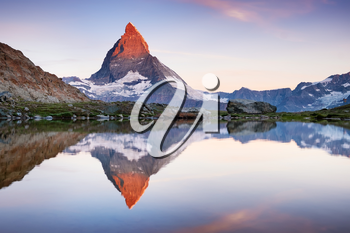 Matterhorn and reflection on the water surface during sunrise. Beautiful natural landscape in the Switzerland