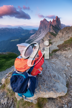Tourist make a photo by a phone on the high mountain top. Adventure and travel concept. People traveling in the mountains. Dolomite Alps, Italy.