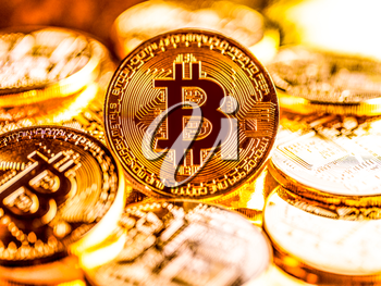 Lots of golden bitcoins. Business background concept with bitcoin criptocurrency