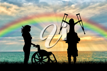 Happy disabled child on the father shoulders holding crutches nurse and wheelchair rainbow sea. Concept child disabled