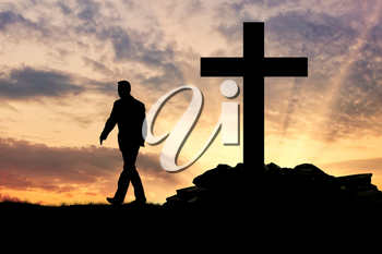 ?oncept of an atheist. Silhouette of a man on the background of the cross at sunset