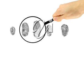 Security Concept. Examination of fingerprints under a magnifying glass