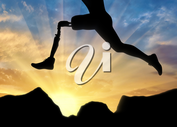 Concept of disability. Man with the prosthetic leg runs and jumps over rocks