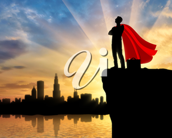 Superman businessman superhero. Silhouette of a confident superman businessman with a briefcase looking at the city from the top