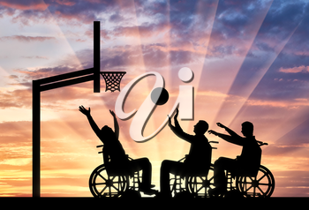 Three disabled to play wheelchair basketball. The concept of sports lifestyle people with disabilities
