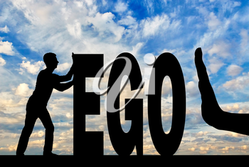 Gesture of the hand stop and silhouette of the man pushing the word ego. The concept of egoism as a problem in society