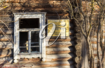 Window of an abandoned house. Medical clinic of the village of Palcevo, Russia.