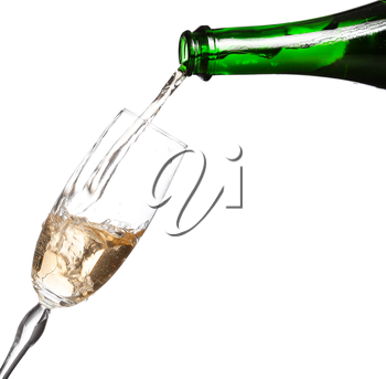 Champagne being poured into glass or flute, isolated on a white background.
