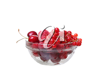 raspberries and currants cherries in a glass on white