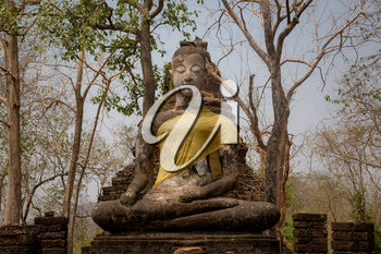 Si Satchanalai Historical Park Is the historical park of Thailand Built in the Sukhothai period Received cultural heritage registration From UNESCO. sitting buddha statue decorated with cloth