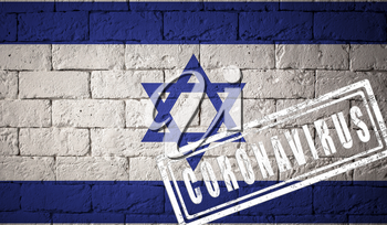 Flag of the Israel with original proportions. stamped of Coronavirus. brick wall texture. Corona virus concept. On the verge of a COVID-19 or 2019-nCoV Pandemic.