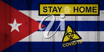 Flag of the Cuba in original proportions. Quarantine and isolation - Stay at home. flag with biohazard symbol and inscription COVID-19.