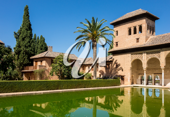 Courtyard and reflecting pool of Partal in Alta Alhambra in ancient city of Granada in Andalucia, Spain, Europe